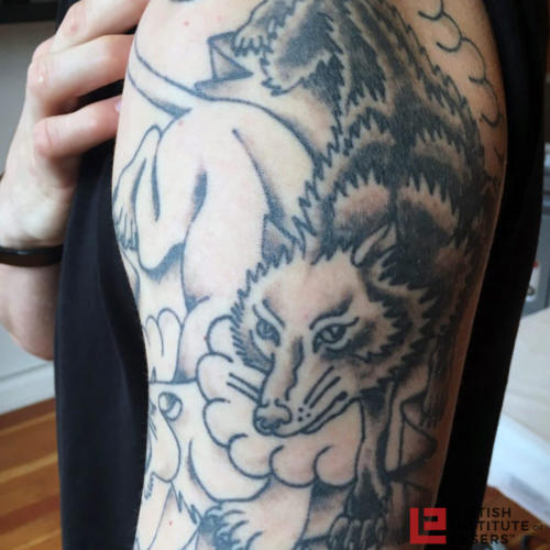 Wolf & Panther Upper Arm Tattoo 2